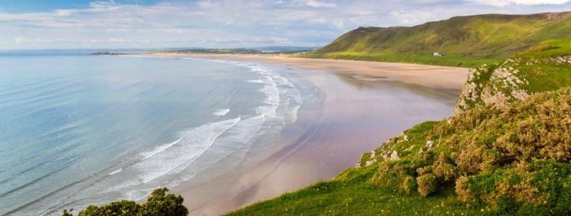 Bei einem Urlaub in Wales muss man den Rhossili Bay gesehen haben